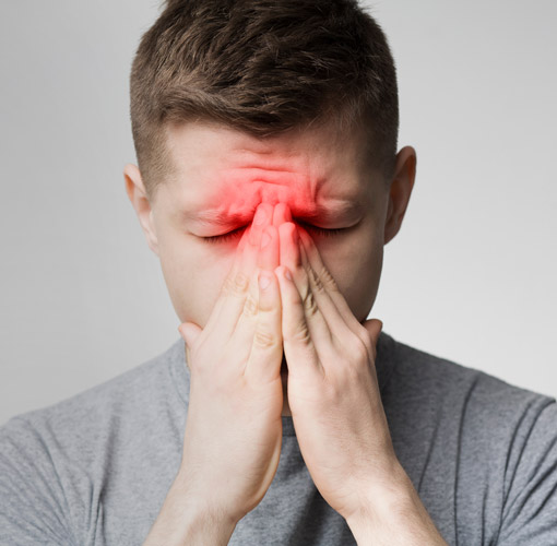 Man holding his sinuses